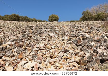Landscape With Rocky Ground And Trees In Cabaneros, Spain