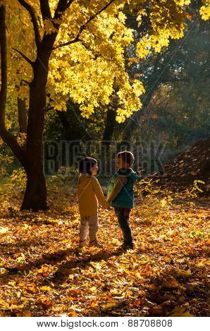 Happy children walking in the autumn park