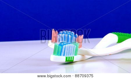 Close-up Of  Blue  Abd Green Tooth Brushes