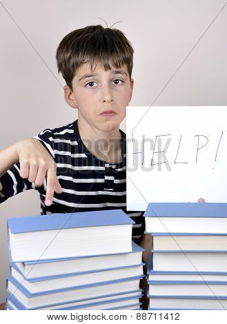 Sad and disappointed young boy and books