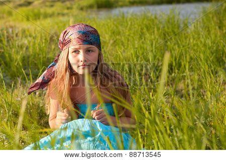 Beautiful Girl Sitting On Green Grass, Summer