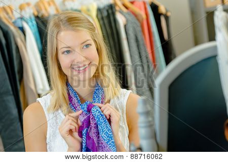Woman trying on a colourful scarf