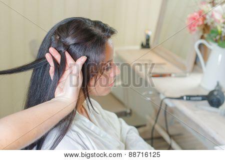 Brunette having her hair re-styled