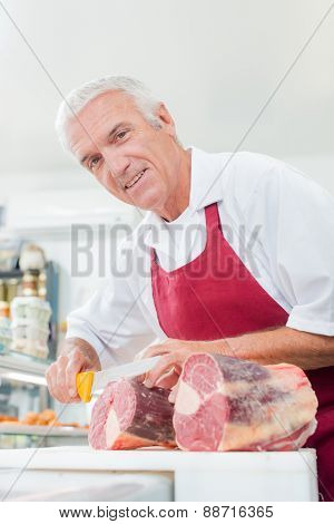 Butcher slicing some meat