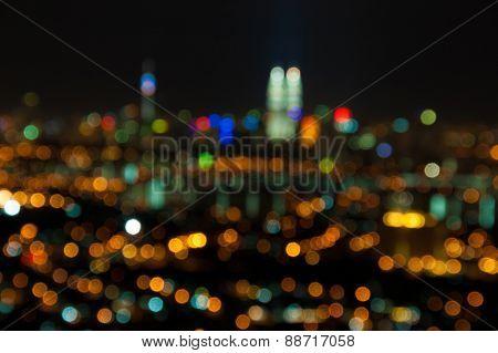 Blurred lights of Kuala Lumpur skyline, purposely defocused.