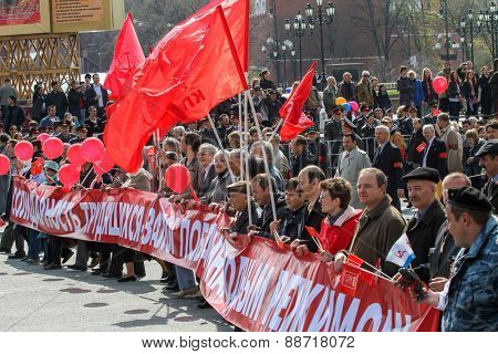 MOSCOW, RUSSIA - MAY 1, 2010: During the celebration of May Day. Communist party supporters take part in a rally.