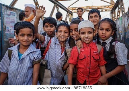 MUMBAI, INDIA - 12 JANUARY 2015: Indian children after school in Dharavi slum
