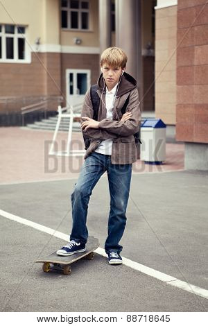 School Teen With Schoolbag And Skateboard