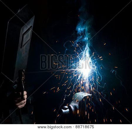 Welder work in dark