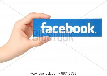 KIEV UKRAINE - MARCH 7 2015: Hand holds facebook logo