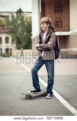 School Teen With Schoolbag And Skateboard