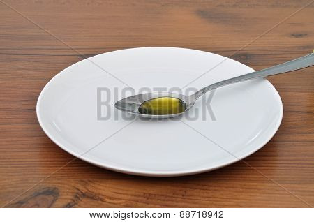 Olive Oil On Spoon