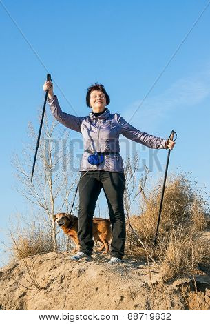 Happy Woman With Sticks For Walking