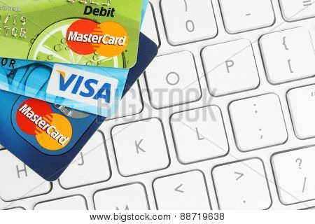 KIEV UKRAINE - MARCH 21 2015: Cards Visa and MasterCard are placed on white keyboard