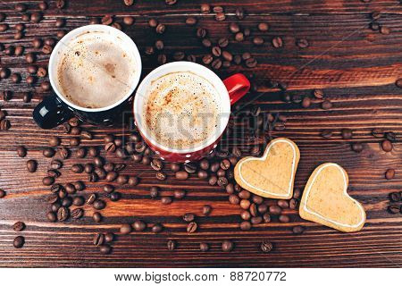 Two cups of coffee with cookies