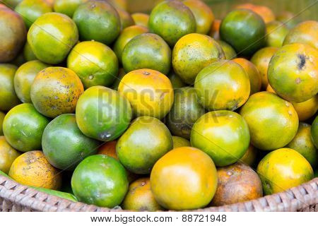 cooking, asian kitchen, sale and food concept - mandarins at street market