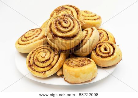Fresh Sweet Homemade Cinnamon Rolls In A Dish Isolated On White Background