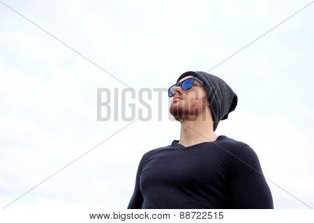 Handsome cool man with cap wool looking away