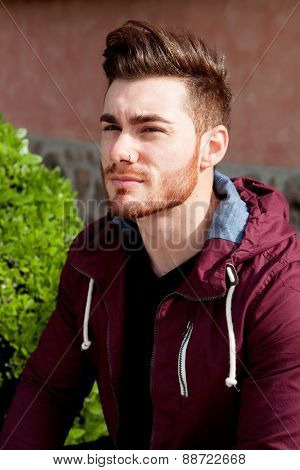 Casual cool young man with beard in the park