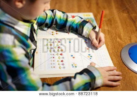 Little Boy Writing Math Homework