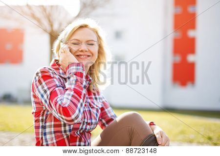 Blonde Businesswoman Calling By Smartphone In Park
