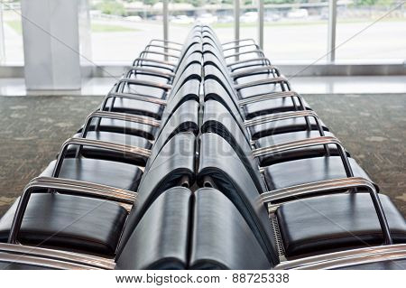 Long Row Of Empty Seating In Airport
