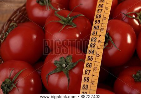 Ripe Tomatoes And Measuring Tape