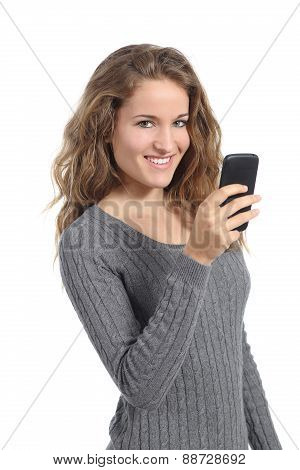 Beautiful Woman Texting On A Mobile Phone Looking At Camera