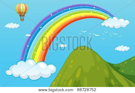 View of rainbow over the mountain