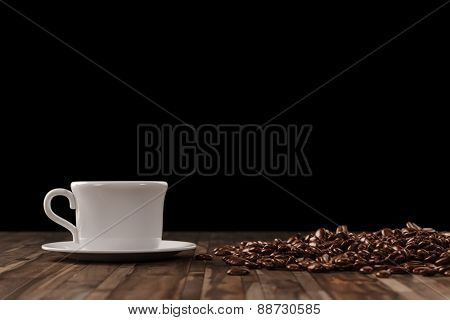 Cup of coffee with many coffee beans with a black background (3D Rendering)