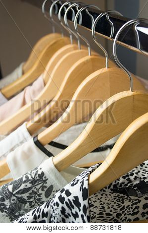 row of white dress in wardrobe at home