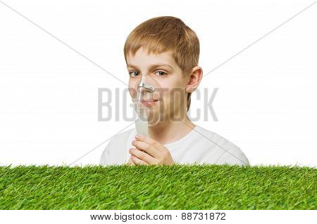 Smiling boy breathing through inhalator mask
