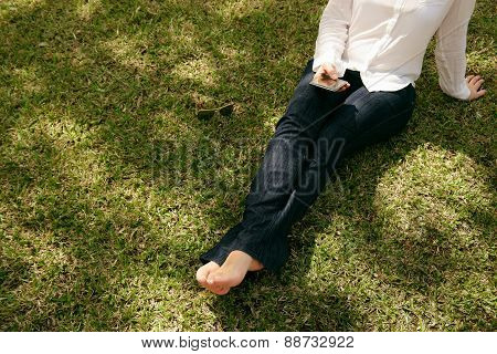 High Angle Woman Texting Mobile Phone Sitting Grass