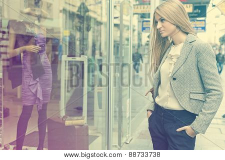 Customer woman in shoping street, looking at window, outdoor