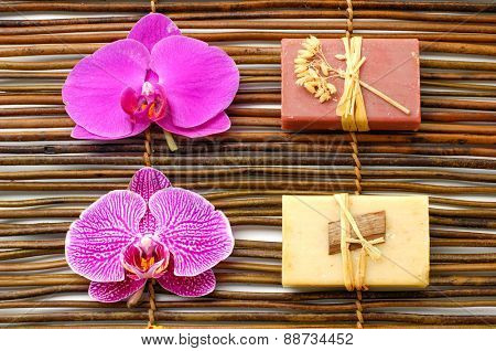 Set of nature soap with orchid on bamboo mat