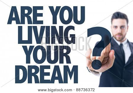 Business man pointing the text: Are You Living Your Dream?