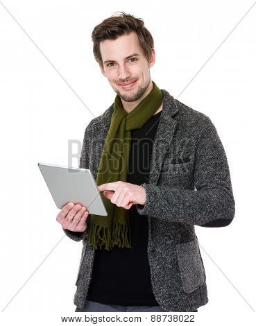 Caucasian man looks at mobile phone