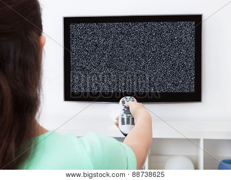 Woman Changing Television Channel