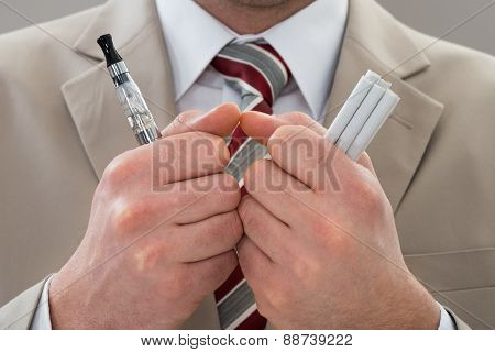 Businessperson With Electronic Cigarette