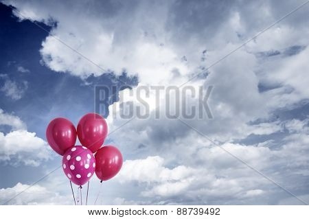 balloons with cloudy sky