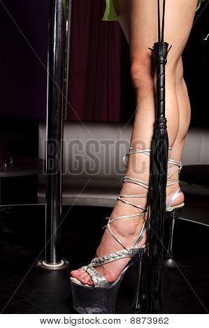 Woman's Leg And Leather Flogger