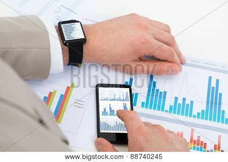 Businessman With Mobile Phone And Smartwatch