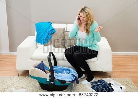 Woman Talking On Mobile In Living Room