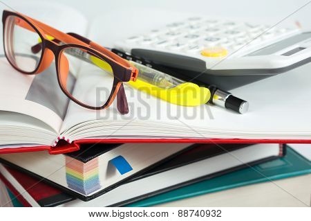 Book Stack With Glasses And Calculator