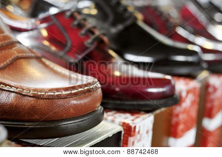 closeup of some different man shoes on sale in a street market
