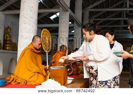 People Offer Rice On Buddhist Monk Alms Bowl