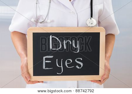 Doctor Holding Chalkboard With The Text Dry Eyes