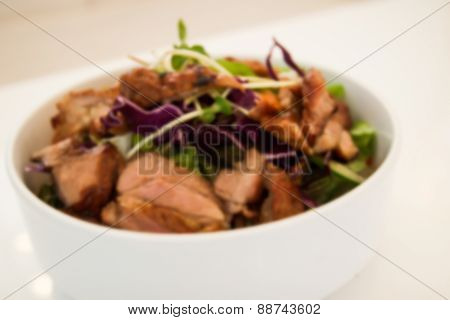 Blurry Defocused Image Of Grilled Pork With Mixed Vegetable Salad For Background