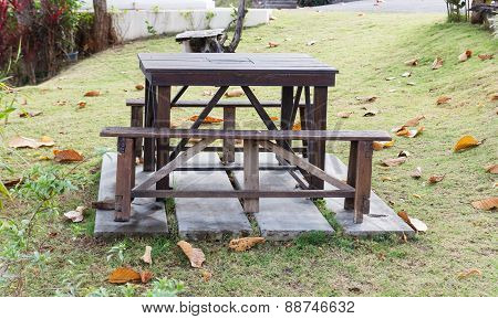 Wooden Bench And Table Near The House