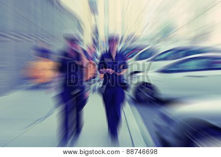 Abstract Background. Two Female Police Officers Walking Along The Streets Of Vienna In Austria. Radi